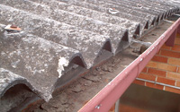 corrugated asbestos cement roof cladding with asbestos debris
