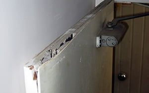 Badly damaged asbestos cored firedoor