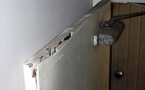Badly damaged asbestos cored firedoor