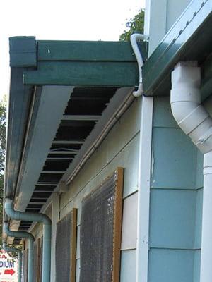 Vandalised asbestos cement sheet eaves lining